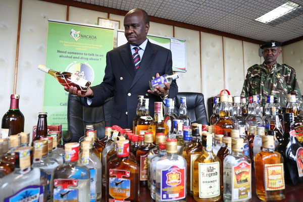 Kenya's NACADA boss with the drinks he loathes - photo from Nation Media Group